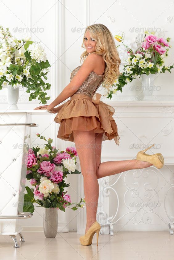 Beautiful  woman in brown dress in luxury interior.. ...  adult, beautiful, blonde, bouquet, brown, elegant, emotion, fashion, flowers, gala, girl, glamour, gown, grand, indoors, interior, long hair, lux, luxuriant, luxury, model, one, party, portrait, posing, romantic, seductive, sexy, short, smiling, studio, style, woman