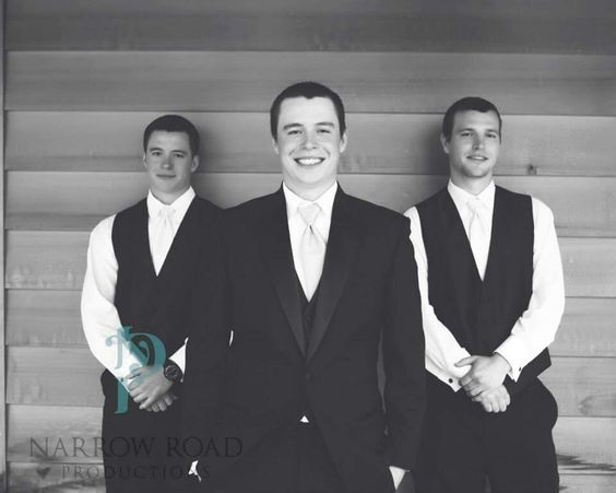 Best man, groom and groomsman   Groomsmen in vests and no jacket