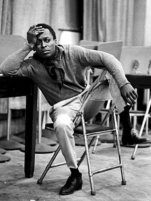Miles Davis demonstrates casual-and-timeless. the scarf is the only thing here harder to pull off than it was in the 50's.