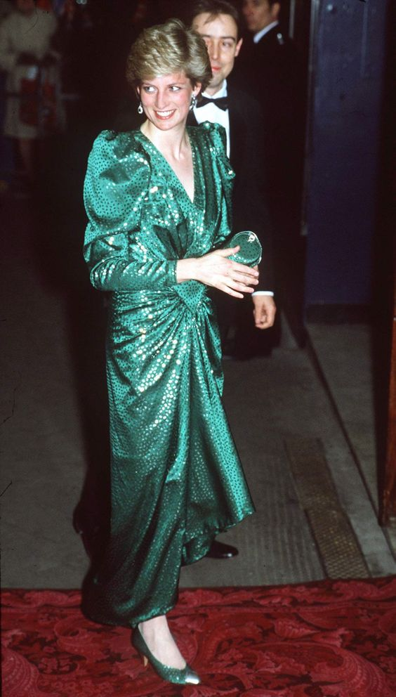 February 23, 1987 In a sparkling, emerald-green dress and matching clutch at a performance of High Society in London.