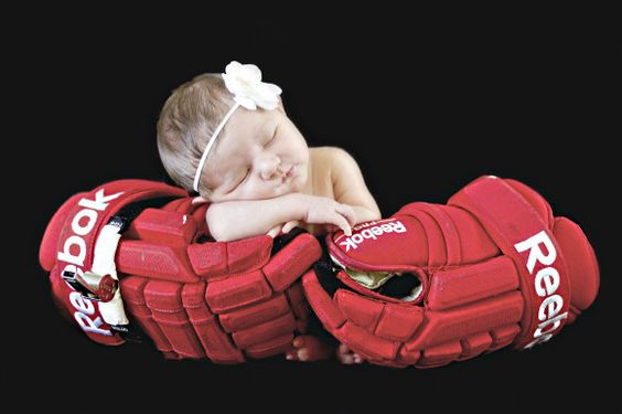 10 Things Your Newborn Photographer Wants You To Know. //  Newborn pullbacks are my favorite! Newborn in hockey gloves!!!