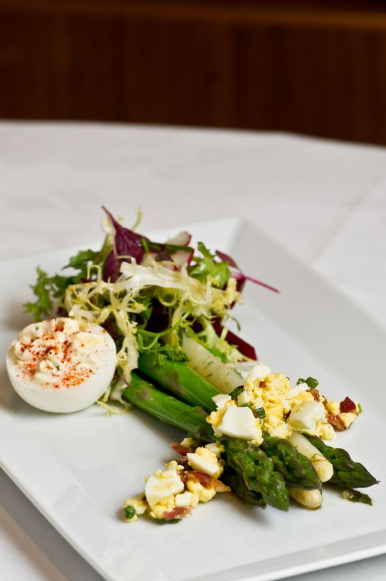 Asparagus, pickled beets, organic egg mimosa and bacon bits, fresh herb salad, meyer lemon dressing made by Belgian Master Chef Steven De Bruyn at REIN at The Garden City Hotel.