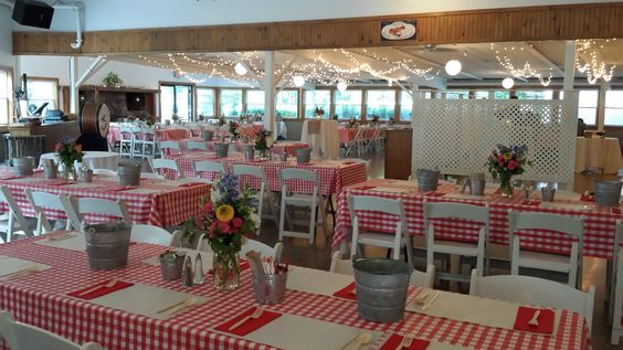 Checkered table clothes set up in Foster's Pavilion for an authentic Maine lobster and clambake in York, Maine.