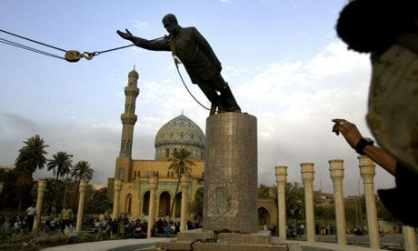 iraq war 2003 pulling down Sadam's statue