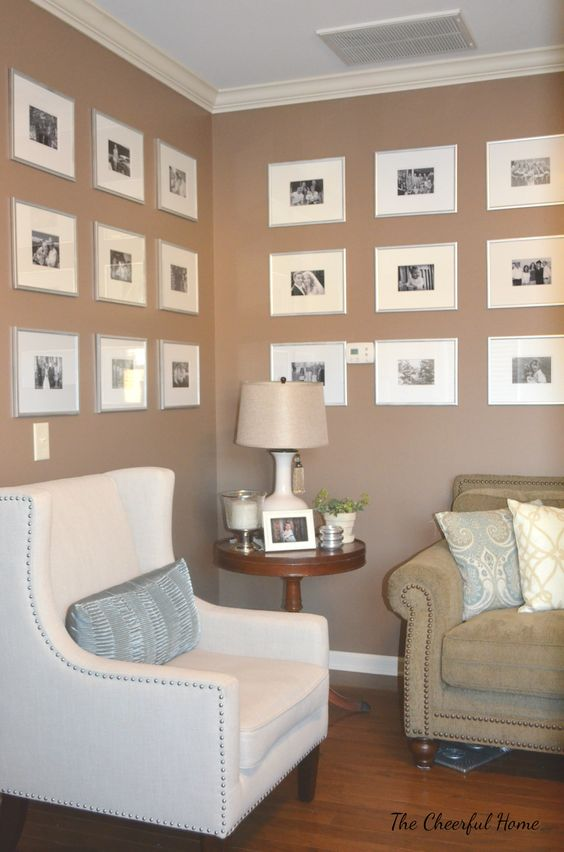 Living room gallery wall with black and white photos by The Cheerful Home