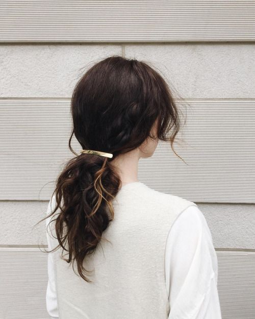 Pull that hair back with a cute clip. Works great for medium length hairstyles!