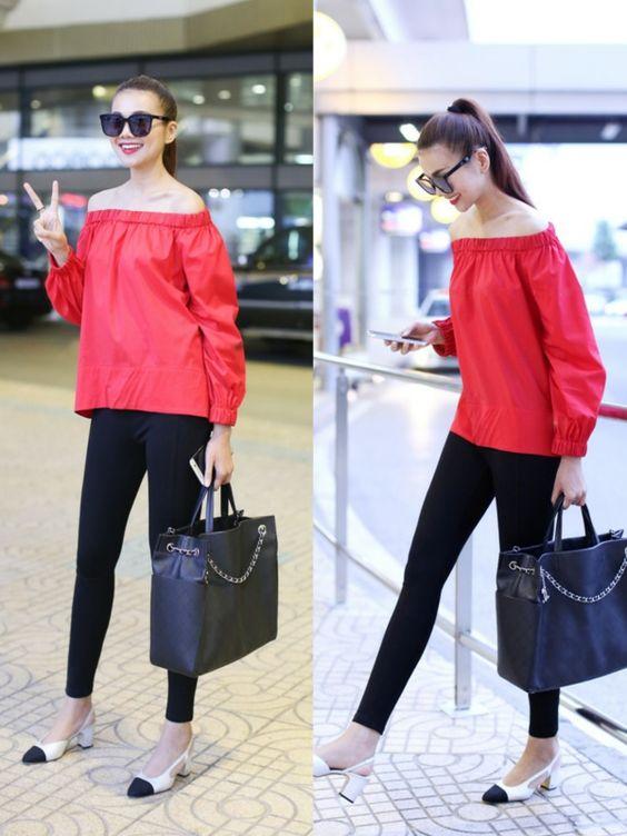 Siêu mẫu Thanh Hằng nữ tính với áo trễ vai (off shoulder) tông màu đỏ kết hợp với quần skinny dạo phố