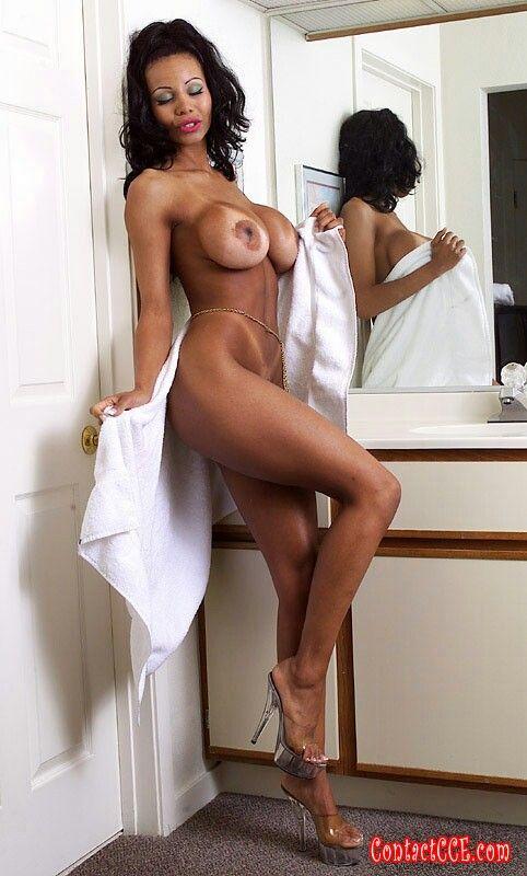 Nude Woman Fixing Cars