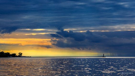 Sunset Storm at the Sodus Light by Mikell Herrick on 500px