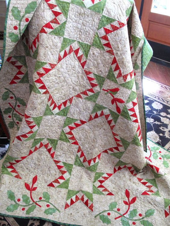 Joy Batik Quilt. Our finished quilt is for sale at www.hollyhillquiltshoppe.com. There is a lot of work in this one with all of those half-square triangles and applique! Excellent piecing by Leilani Chartier and excellent custom quilting by Monica Mesdag