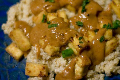 Crispy Tofu with Spicy Peanut Sauce on Coconut Quinoa