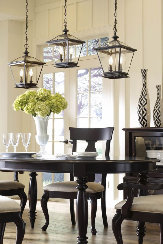 Grouped lanterns above a dining room table add a contemporary flair to