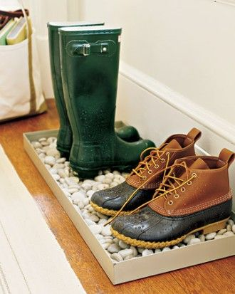 Pebble-Filled Tray  |  Make a boot tray by the door even better: Fill it with stones (found at garden centers). Ice and snow will melt and drain through the rocks to the bottom of the tray, so your boots won't stand in a puddle. Most of the moisture will evaporate, but you should clean out the tray regularly.