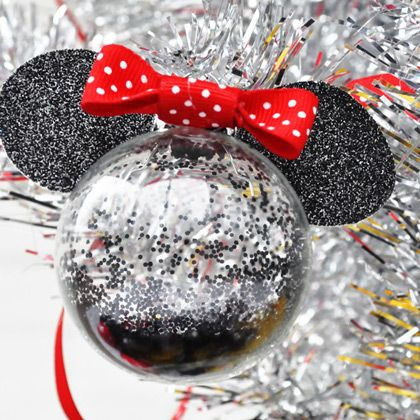 Cute handmade Mickey Mouse Christmas ornament - so simple - pour some black glitter into a glass bauble, add ears and a red spotty bow!