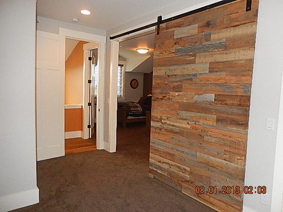 cool way to have adjoin bedrooms with barn doors to make