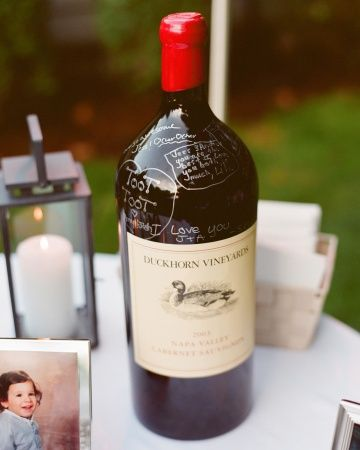 Guests wrote special notes and well wishes on large bottles of locally produced Duckhorn wine