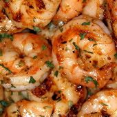 """This garlic shrimp recipe is named for Gilroy, California, known as the """"Garlic Capital of the World."""" This simple shrimp recipe is a delicious and garlicky classic, and only takes a few minutes to cook."""