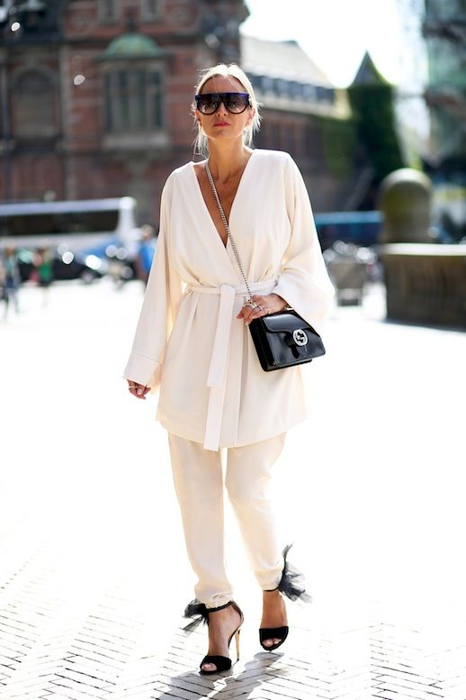 Le Fashion Blog Cfw Street Style Pajama Dressing Trend For Summer White Belted Robe Top Matching Pants Celine Sunglasses Black Leather Gucci Crossbody Bag Ankle Wrapped Sandals with Chiffon Detail Via British Vogue: