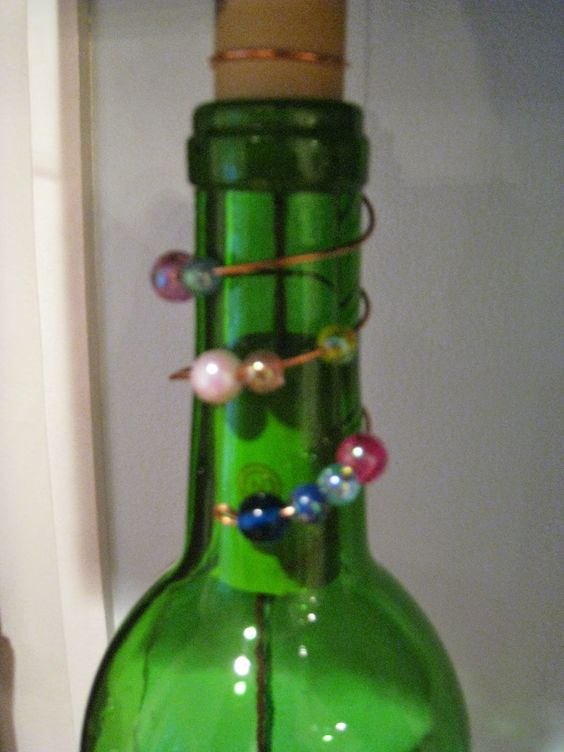 Repurposed for life wine bottle wind chimes crafts for Recycled glass art projects