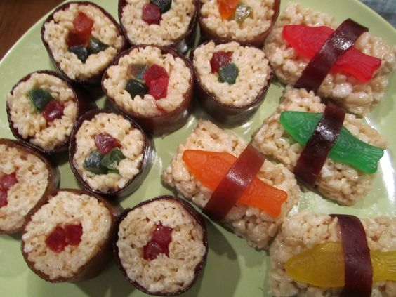 sweet sushi - rice krispie treats with fruit roll ups and gummies - add red sprinkles for the roe? - serve via chopsticks, naturally!