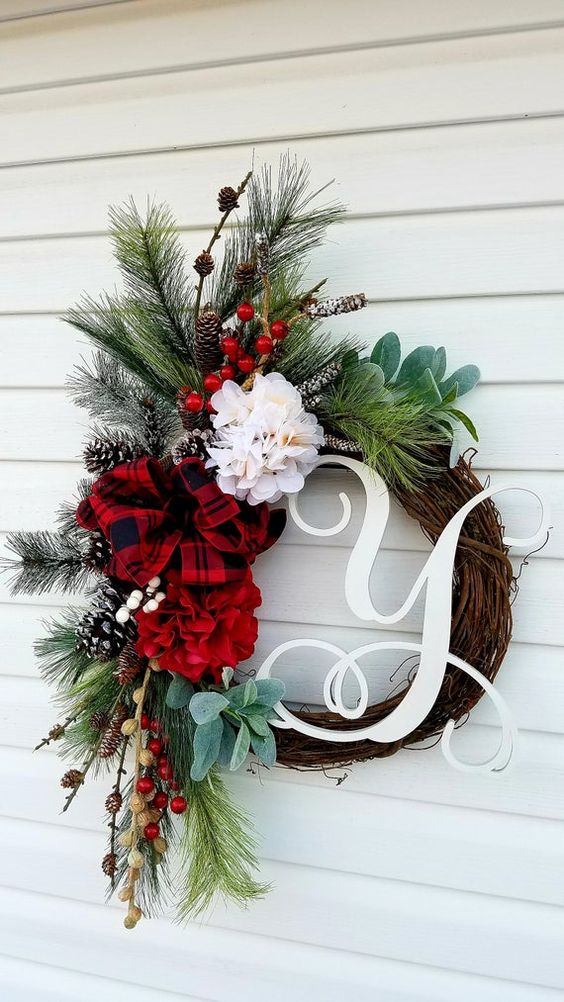 Monogrammed Wreath For Front Door! Stunning Winter wreath made on grapevine base and adorned with pine greenery,red flower,berries,pine cones ,double bow. Would compliment your home inside or out ,for holidays and all season. Monogram letter of your choice makes this wreath a perfect personalized