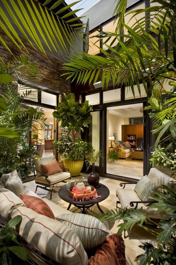 love the tree in the corner & idea of cushy chairs you'd actually want to sit in for a good while