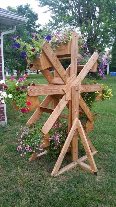 I Call This The Flowris Wheel Bahce Tasarim Fikirleri Ahsap Isleme Lodos Tahtasi Projeleri