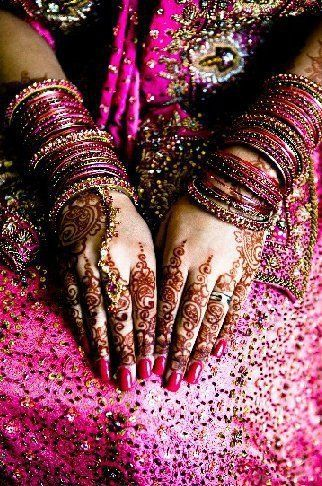So Pretty. The stuff on her hand is called Henna. We put this on the bride when it is her wedding.