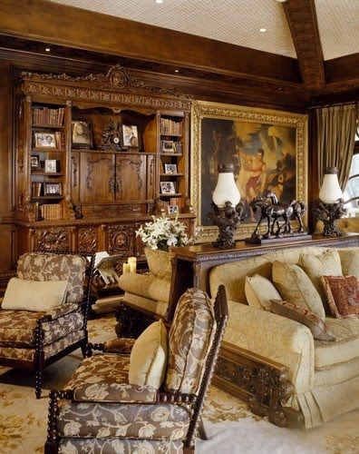A living area (library?) in the palatial mansion of Mohammed Hadid. Love the architectural details of rich wood paneling -