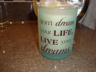 I found this candle at Joann's.  The colors match and the saying for this bathroom is right on the money.  I placed this one and another matching one on the window sill to fill the space and add some color.