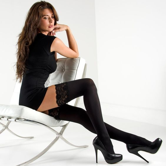 Long legs in thigh high lace stockings and platform high heels