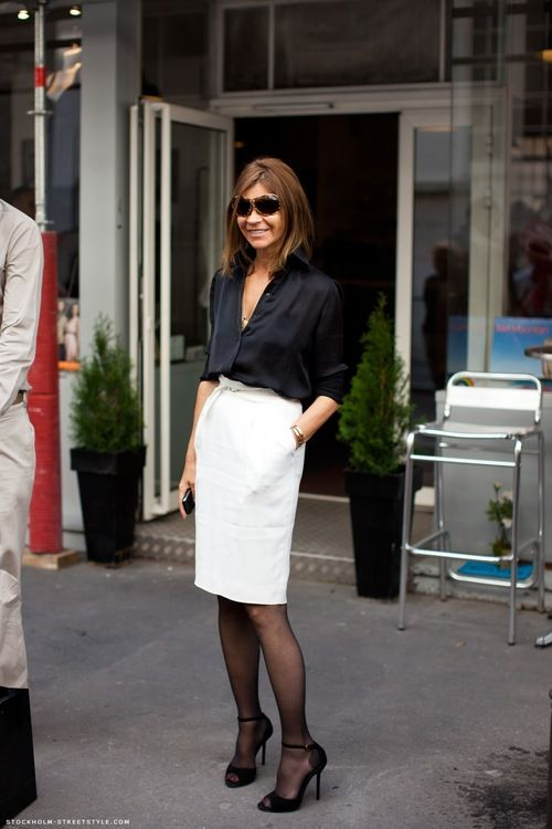 Carine Roitfeld in Paris. Classic black blouse & white pencil skirt.