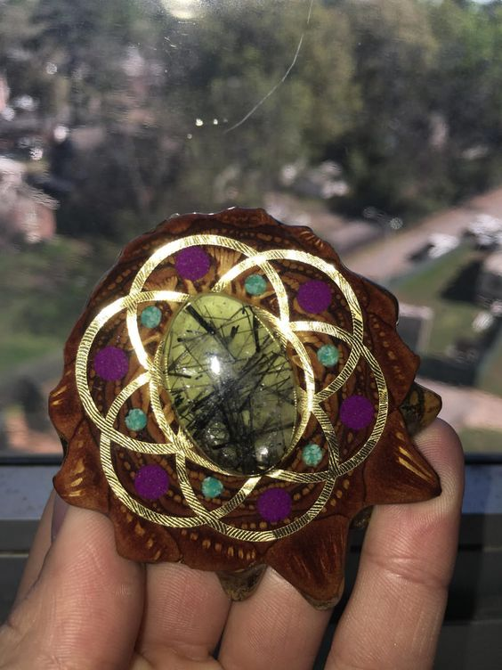 Can someone help me figure out what the stone is in this pine cone necklace?