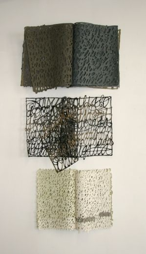 Calligraphy done with paper pulp make up these sculptures by Miriam Londoño