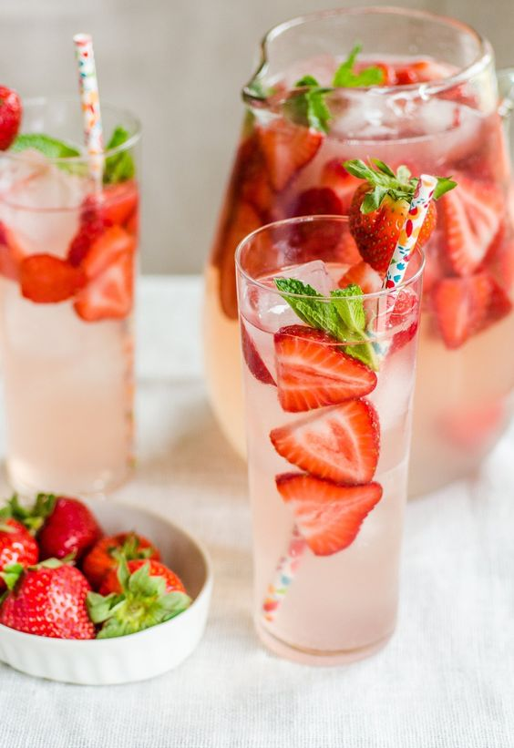 Strawberry gin smash. Includes recipe for a glass or a pitcher. And can be made ahead.