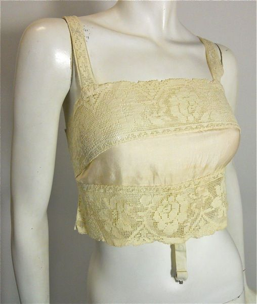 Ivory satin and lace bandeau bras with lace-up back, by Nemo Brassieres, c. 1920's.