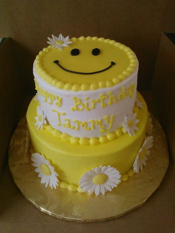 Chocolate and vanilla cake, with fondant smiley face, and gumpaste daisies.