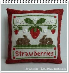 love this cross stitched strawberry tiny pillow