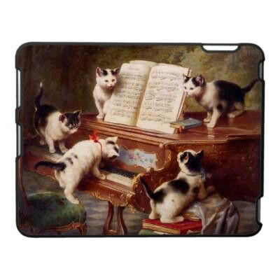 Kittens playing piano