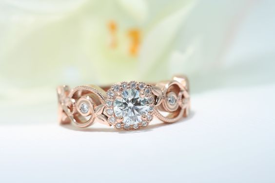 Jessica design Rose gold vintage floral halo engagement ring with migraine. #Vintageinpiredengagement #Vintage #Engagementring #Halo #Rosegold