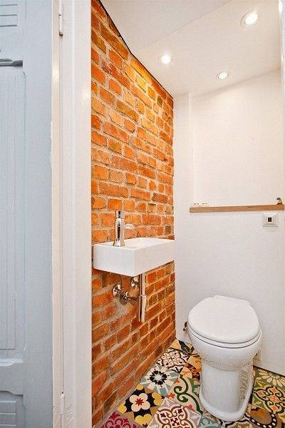 Small bathroom with a mix of tiles