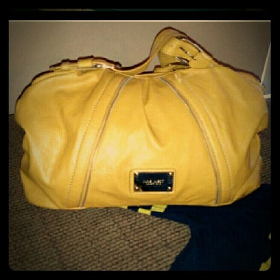 YELLOW Nine West Purse Nine West mustard yellow  purse  tear on inside but nothing that damages purses functions.  Some small black marks on bottom back nothing noticeable. Medium size. Nine West Bags Shoulder Bags