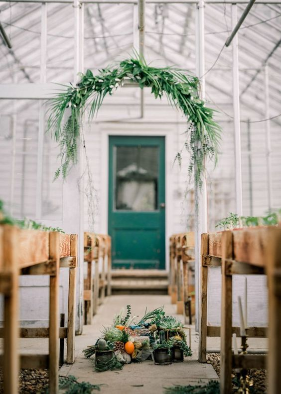 This intimate greenhouse ceremony features minimal florals + pops of orange | Image by Barbara Rahal Photography