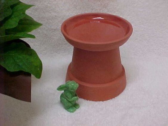 Upside down flower pot tart warmer terra cotta...we could SO make this!