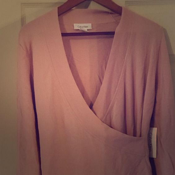 NWT pink Calvin Klein wrap sweater sz medium Beautiful light pink Calvin Klein wrap sweater. Very flattering shape and a gorgeous color. Sz medium. NWT nonsmoking home. Calvin Klein Sweaters V-Necks