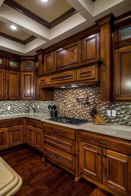 Cherry Cabinets, Quartz Countertops And Glass Tiles On
