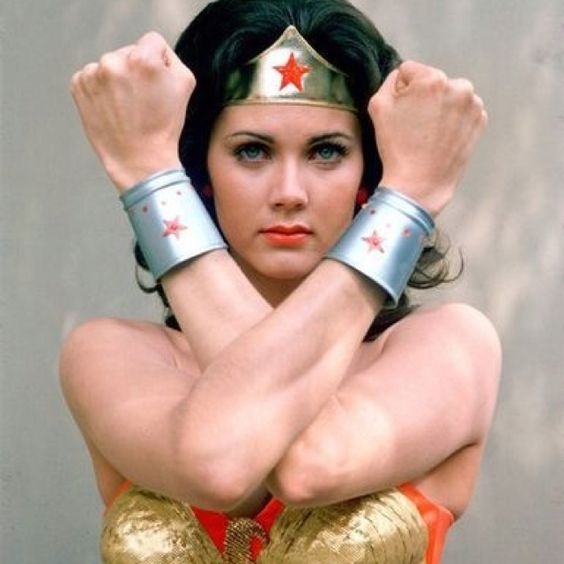 Wonder Woman...I wanted to be just like her steel bra and all!!