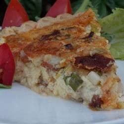 """Chef John's Quiche Lorraine   """"What's not to like—cheese, bacon, and cream, along with onion, and you have a match made in heaven."""" –Baking Nana"""