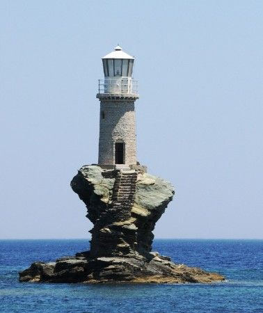 Faros Tourlitis, Greece  Only accessible by boat....no keeper quarters.  The stair are carved out of the rock its sitting on