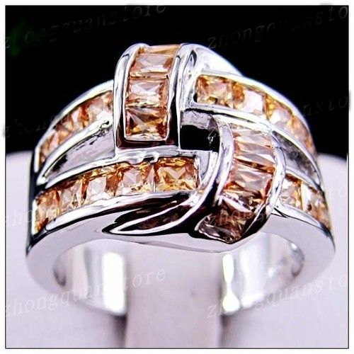 '(R) Gorgeous Champagne Topaz Ring' is going up for auction at  7pm Mon, Nov 26 with a starting bid of $12.